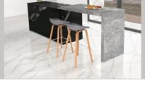 Kitchen by Lioli Ceramica - Statuario Venato on floor, Black Cosmos as backsplash and dining top of Grey William