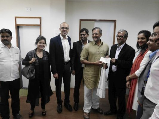 Technip team hands over cheque to Nana Patekar and Naam Foundation. naammh.org/