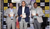 During book launch of Retail Beyond Detail by author Dr Gibson G. Vedamani along with Rakesh Biyani (JMD of Future Group)